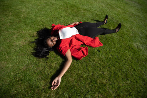 Undergaduate student Ambassador in red gown taking a break from Graduation duties at the University of St Andrews