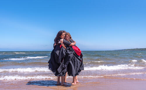 Graduates of the University of St Andrews on the East Sands after Graduation