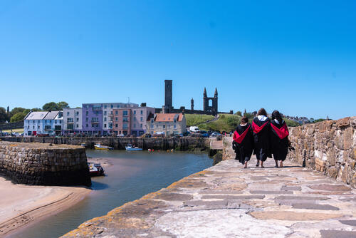 Friends from the University of St Andrews walking along the Pier on Graduation Day