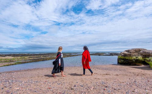 Graduate and Undergraduate from the University of St Andrews on Castle Sands on Graduation Day