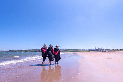 Friends from the University of St Andrews celebrating Graduation on the East Sands