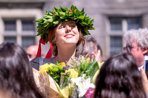 Graduate in traditional Italian headwear for Graduation Day at the University of St Andrews