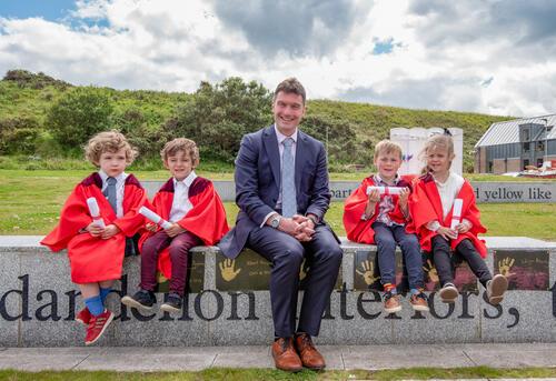 Fresh 'graduates' from the University of St Andrews Nursery with VP Brad MacKay