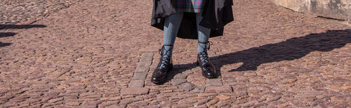 Graduate's feet wearing traditional kilt shoes and socks on the PH cobbles