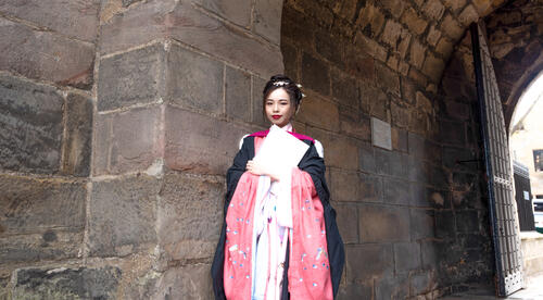 Graduate in traditional dress from China on Graduation Day at the University of St Andrews