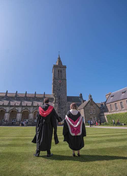 Graduates holding hands after Graduating from the University of St Andrews