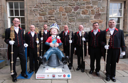 Mace-bearers posing with 'Oor Wullie' on Graduation Day at the University of St Andrews