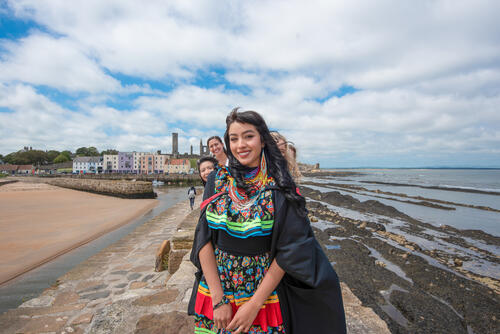 A group of friends celebrating Graduation at the University of St Andrews on St Andrews Pier