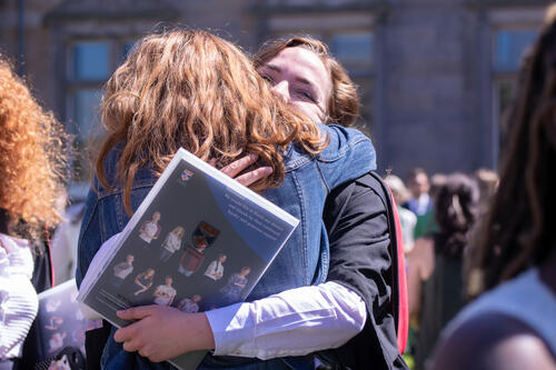 Graduate hugging friend after Graduation Day at the University of St Andrews