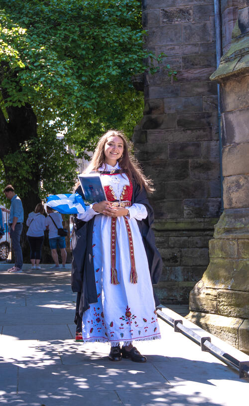 Graduate in traditional dress on Graduation Day at the University of St Andrews