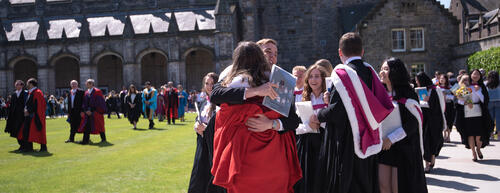 Students hugging eachother on Graduation Day at the University of St Andrews