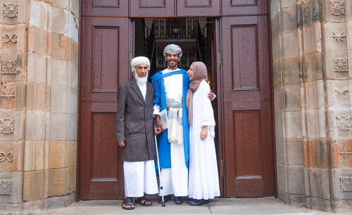 Graduate in traditional national costume with his family at the University of St Andrews