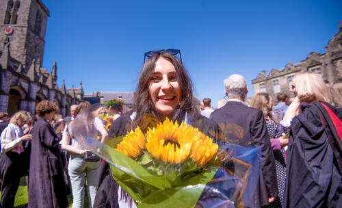 Graduate smiling after Graduation Day at the University of St Andrews
