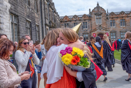 Graduate hugging a friend after Graduation from the University of St Andrews
