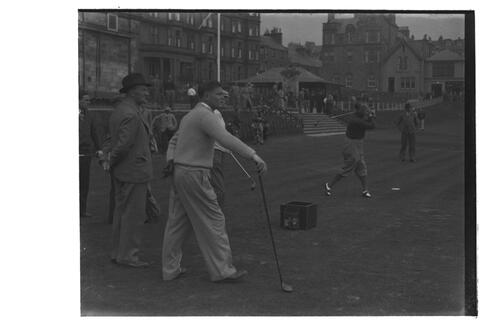 Hector Thomson watching golfer tee off in the Amateur Golf Championship, the Old Course, St Andrews.