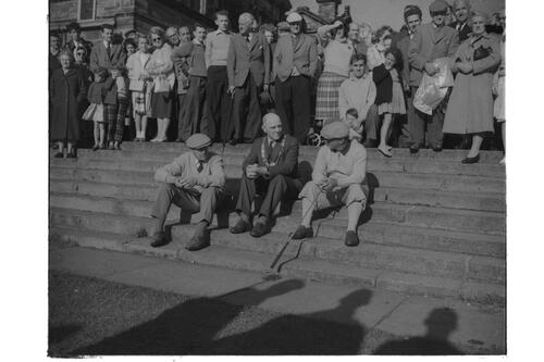 Henry Cotton v Gene Sarazen [& the Provost]; golf match for TV [St Andrews]. Sitting on the steps before the Royal and Ancient Golf Clubhouse.