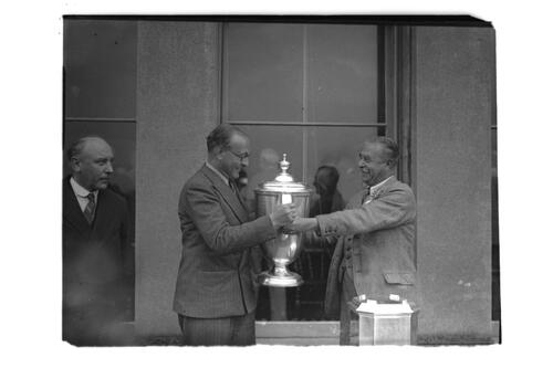 The Walker Cup Match 1934. Sir Ernley Blackwell hands over the Walker Cup to Francis Ouimet the Captain of the winning American Team, the Old Course, St Andrews.