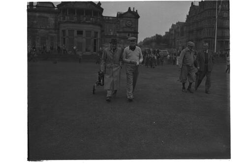 Francis Ouimet and golf partners walks down the 1st fairway, the Old Course. St Andrews