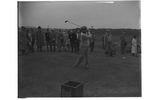 Francis Ouimet tees off watched by his golf partners, the Old Course. St Andrews