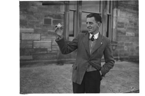 Arthur Speight with the five dollar gold coin, St Andrews.