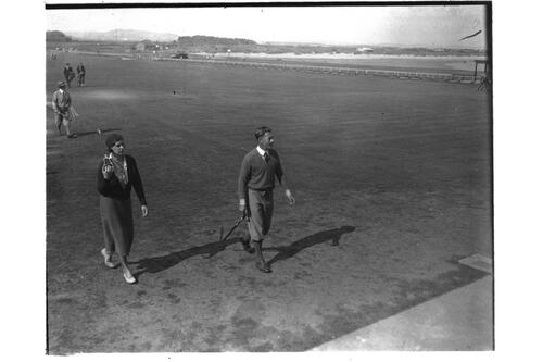 Dorothy Pearson and golfer leaving the Old Course, St Andrews.