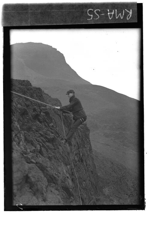 C.W.descending cliff.