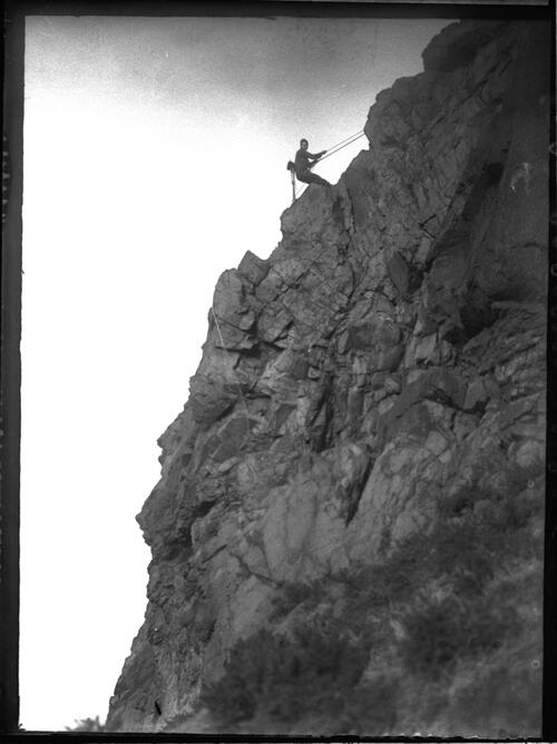 C.W. descending cliff.