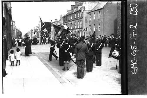 Drumhead service, Standards entering Martyrs Church from North Street, St Andrews.