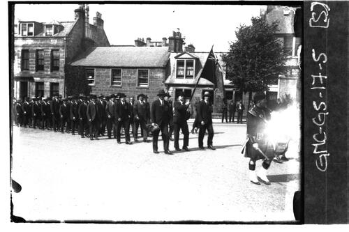 Men marching along North Street, St Andrews.