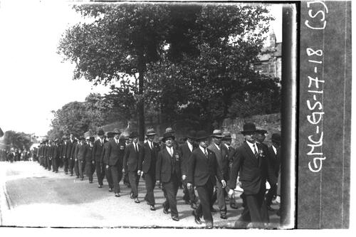 Men marching along road, St Andrews.