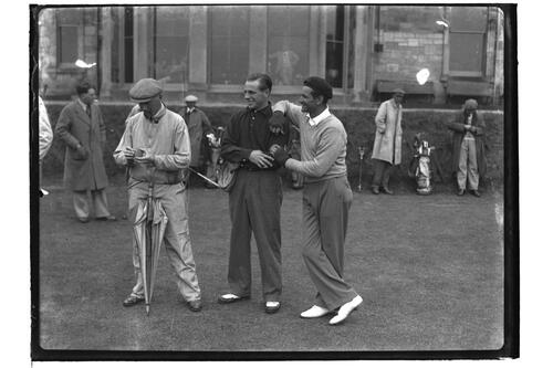 Dick Chapman,USA (?) (on the right) and golfers before the Royal and Ancient Clubhouse, British Amateur Golf Championships, 1936, St Andrews.
