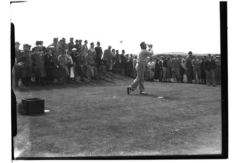Dick Chapman (?) teeing off on the Old Course, British Amateur Golf Championships, 1936, St Andrews.