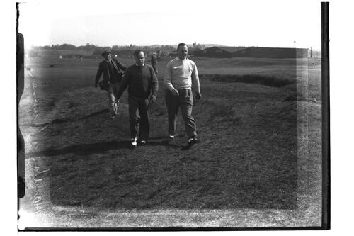 E.W. Hamilton (Sealand Club) and Donald Cameron (Sealand Club) walking down the Old Course, British Amateur Golf Championships, 1936, St Andrews.