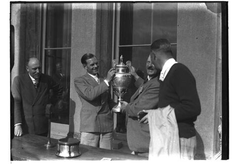 Hector Thomson receiving the Amateur Trophy watched by Henry Gallen, British Amateur Golf Championships, 1936, St Andrews.