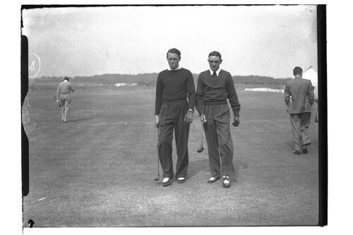 Two golfers walk on the Old Course, the Open Championship, St Andrews 1939.
