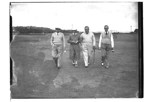 Four golfers walk on the Old Course, the Open Championship, St Andrews 1939.