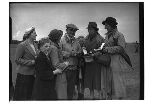 Sandy Herd signs autographs for fans, the Open Championship, St Andrews 1939.