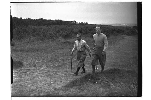 Two golfers walk the Old Course, the Open Championship, St Andrews 1939.