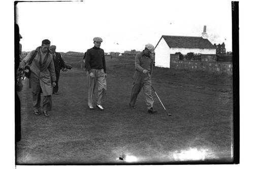 Golfers and caddies walk down the course, the British Amateur Championship, Troon.