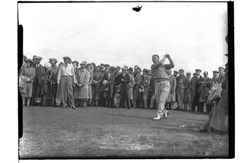?Cecil Ewing (Ireland) tees off at the 11th (The Railway) hole, watched by the crowd, at the British Amateur Championship, Troon.