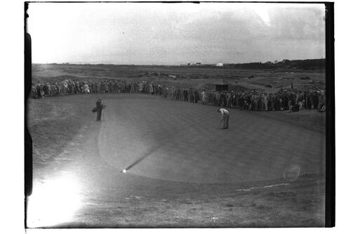 General view - golfer putts, watched by the crowd, at the British Amateur Championship, Troon.