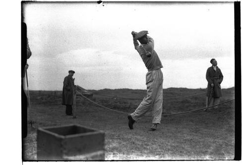 Golfer tees off at the British Amateur Championship, Troon.