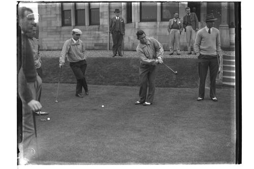 Golfers practising putting before the clubhouse, the British Amateur Championship, Troon.
