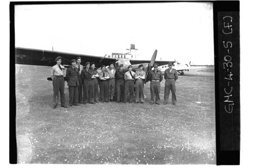 Royal Artillery (Army) and RAF members standing beside plane, RAF Ouston.