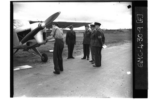 RAF officers inspecting plane, RAF Ouston.