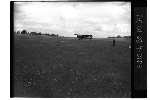 Plane taking off from grass runway, RAF Ouston.