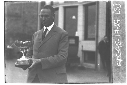"The trophy being presented to T.S. Logan, ""Silver Poppy"" Golf Competition, St Andrews."