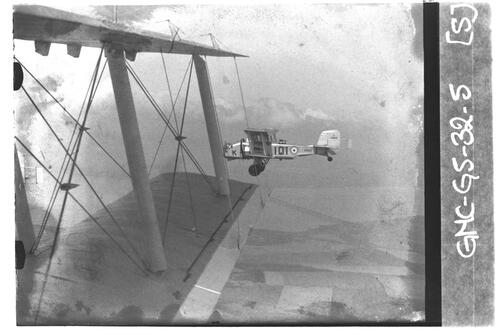 Boltoun Paul Overstrand biplanes flying over the Fife countryside with Tay Rail Bridge in background.