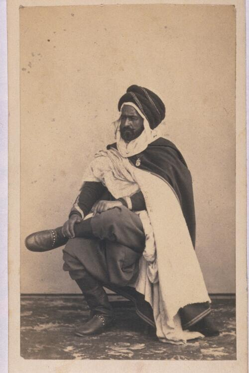 Unidentified man in turban.