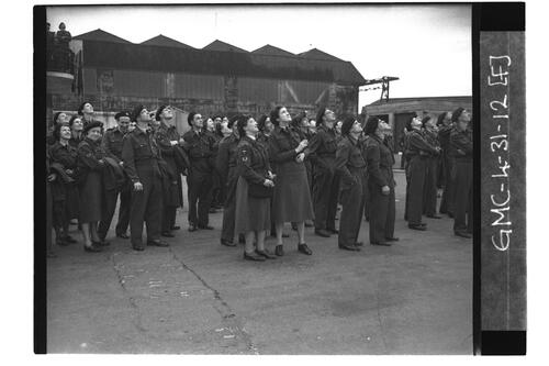 ROC (Royal Observer Corps) personnel standing looking skywards, RAF Leuchars.